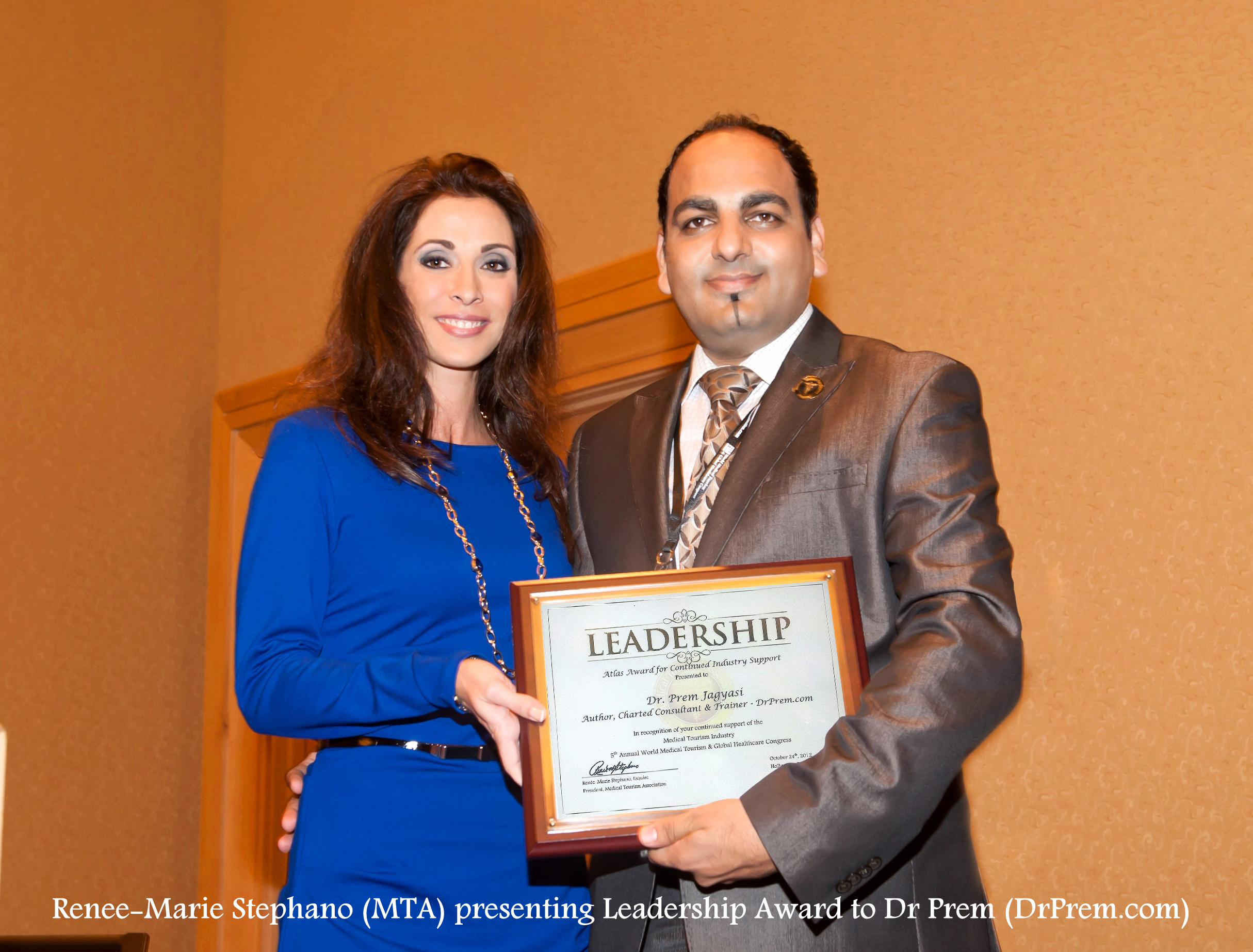Dr Prem Recieving Leadership Award From Renee-Marie Stephano
