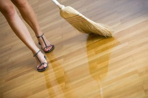 woman-sweeping-wooden-floor