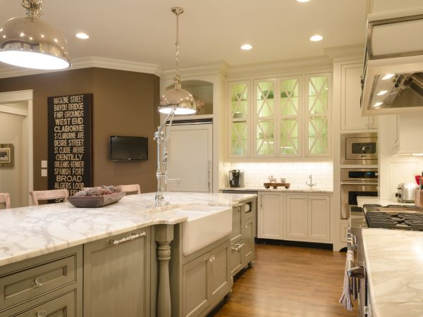 HGTV Remodels Room Stories Transitional Kitchen with butcherblock island and glass-front cabinets.