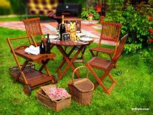 Foldable oval shaped dining table with built-in chair rack